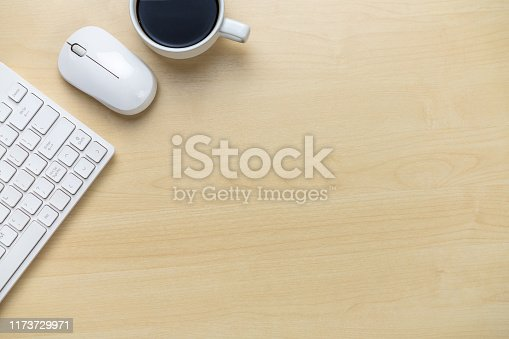 843371502 istock photo Office desk workspace and table background. 1173729971