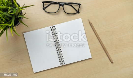 843371502 istock photo Office desk workspace and table background. 1180251482
