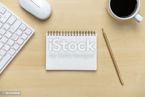 843814242 istock photo Office desk workspace and table background. 1184345506