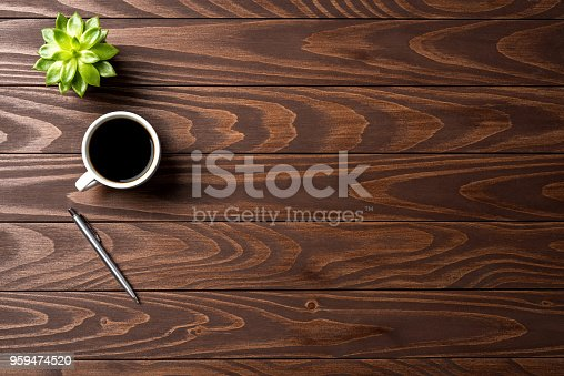 Office desktop with cup of coffee. Top view