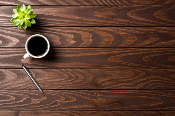 Office desktop with cup of coffee. Top view Office desktop with cup of coffee. Top view directly above stock pictures, royalty-free photos & images