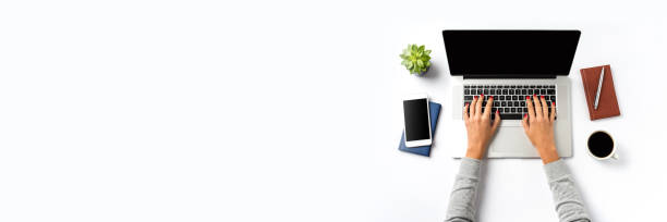 Office desktop with modern laptop and copy space stock photo