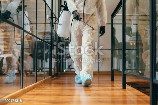 istock Office disinfection during COVID-19 pandemic,stopping the spread of the virus 1220174318