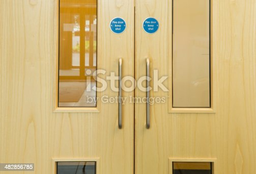 Close up of modern wooden office doors.