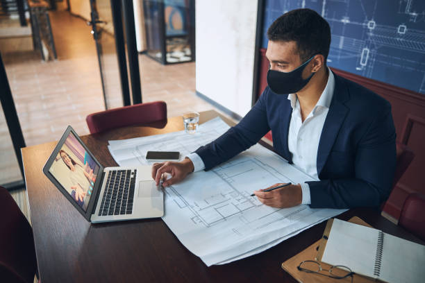Office employee consulting his female colleague online stock photo