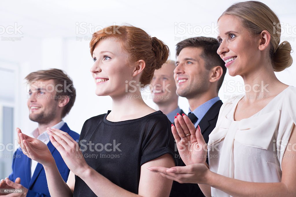 Office employees clapping their hands Lizenzfreies stock-foto