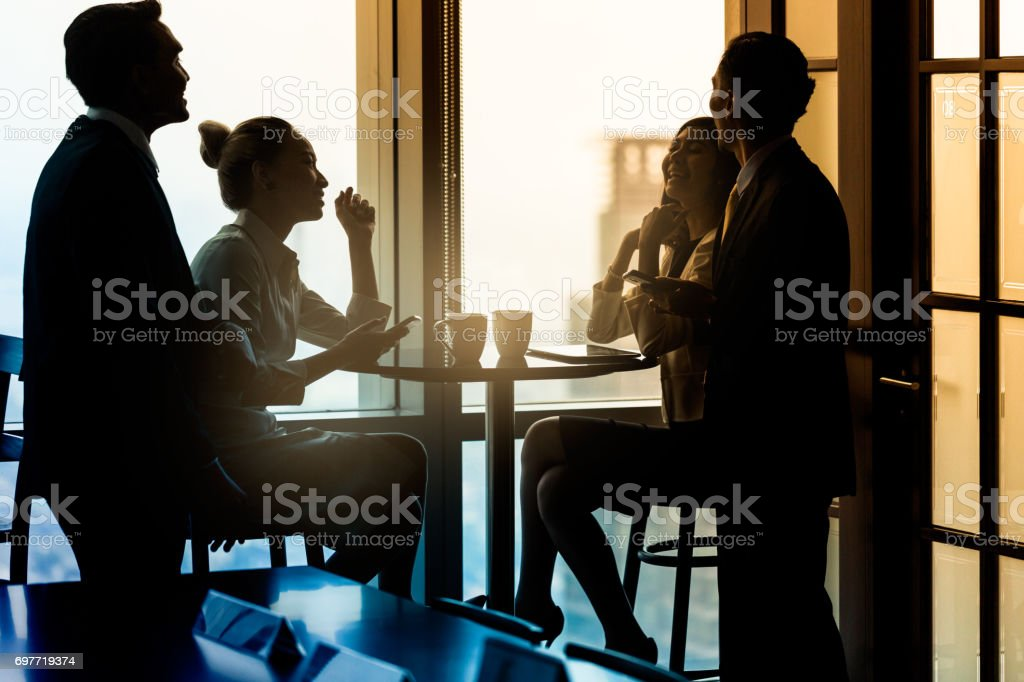 Office employees having coffee break and talking stock photo