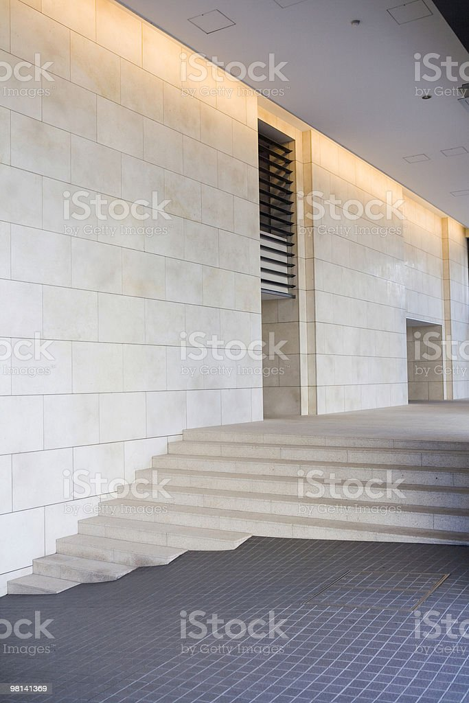Office entry stairs on a slanted driveway royalty-free stock photo