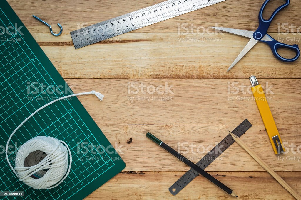 Office equipment or diy tools on wood board stock photo