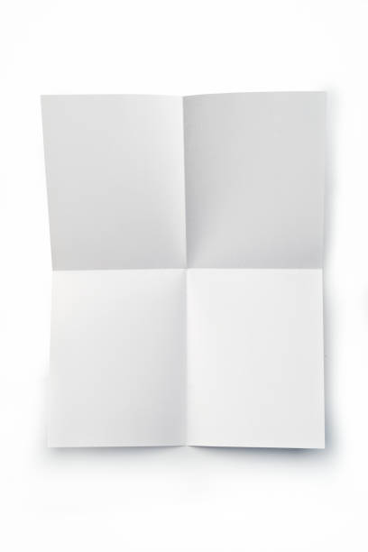 Office: Folded Blank Sheet of Paper on white background stock photo