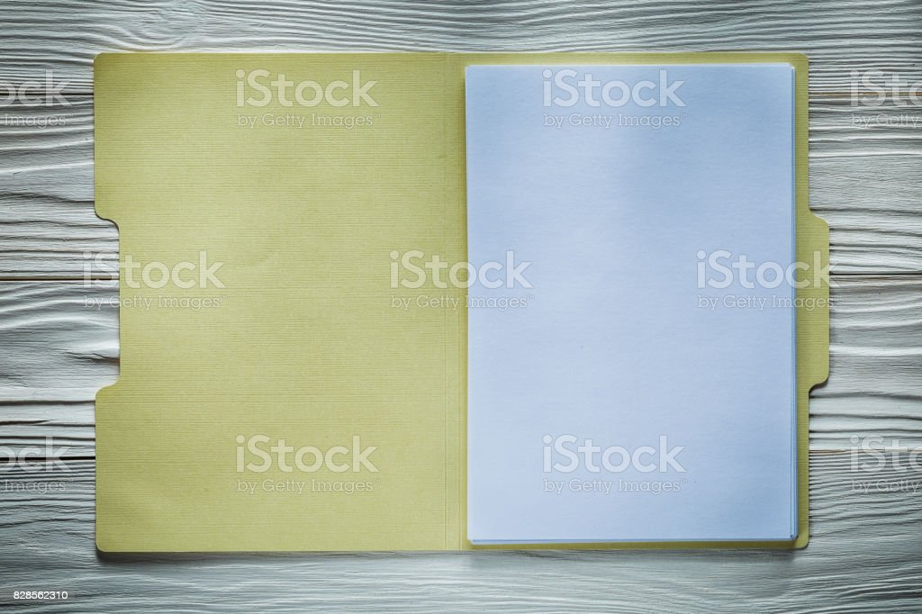 Office folder with blank paper on wooden board stock photo