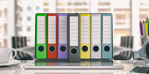 istock Office folders out of a laptop - office background. 3d illustration 1025773736