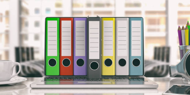 Office folders out of a laptop - office background. 3d illustration Colorful ring binders out of a laptop screen in an office. 3d illustration telephone directory stock pictures, royalty-free photos & images