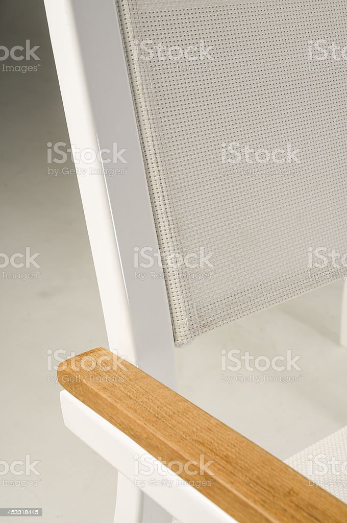 Office Furniture Macro mesh Textile And Wood Armrest stock photo