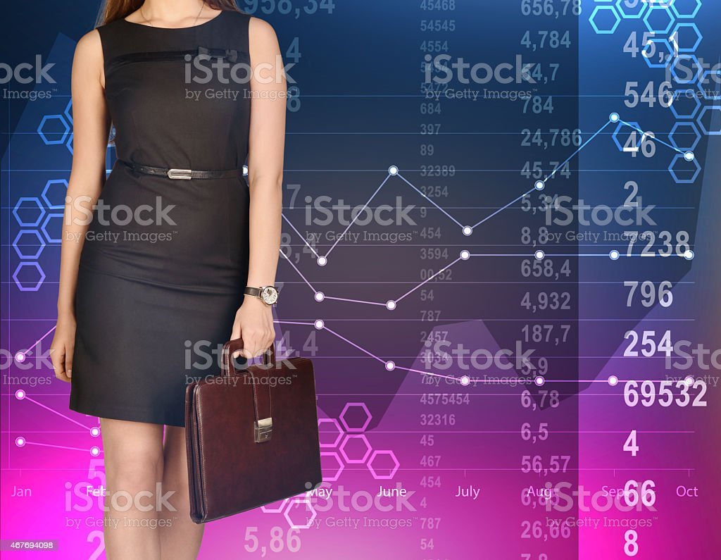 office girl holding leather briefcase on colorful background of diagrams  royalty-free stock photo