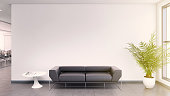 Office interior lobby . Blank wall for copy space, lots of light, sunlight scene. Black leather sofa. gray floor tiles. daylight scene. designer copy space background