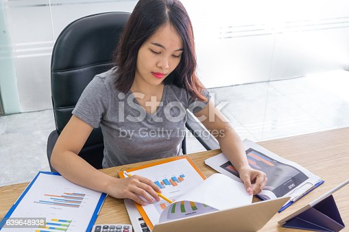 istock Office lady analyzing graphs on sales reports 639648938