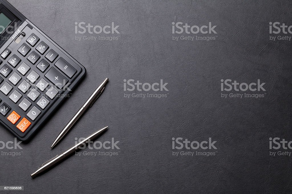 Office leather desk table with calculator, pen and pencil stock photo