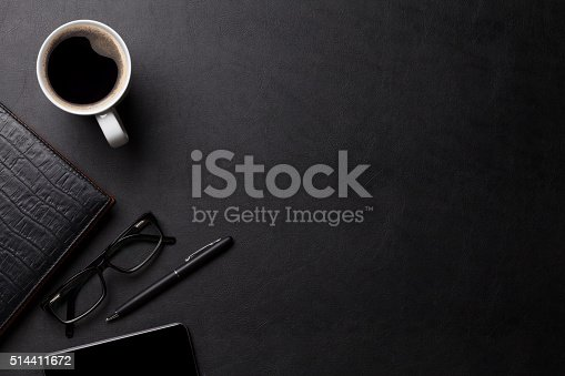 istock Office leather desk table with coffee and supplies 514411672