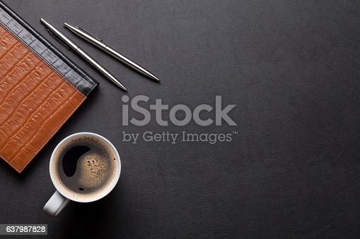 istock Office leather desk table with notepad and coffee 637987828