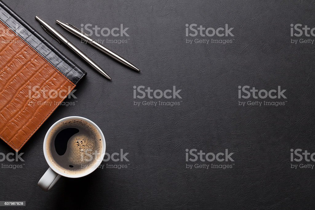 Office leather desk table with notepad and coffee stock photo