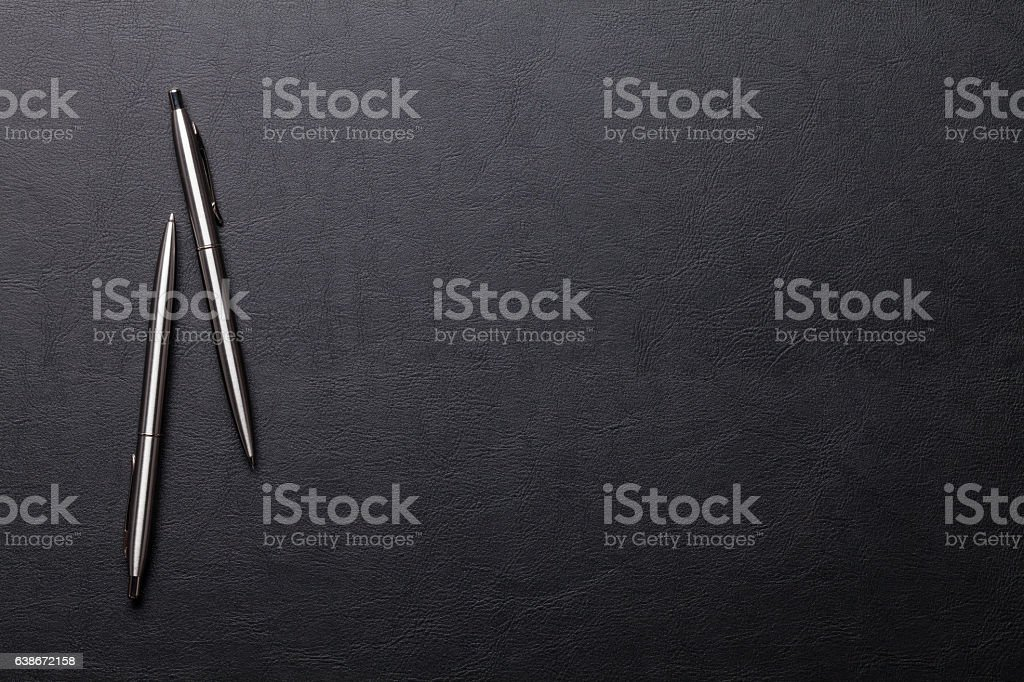 Office leather desk table with pen and pencil stock photo