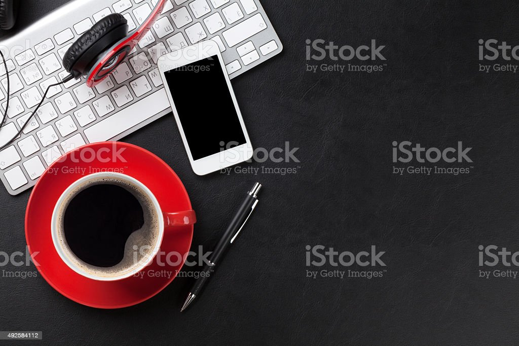 Office leather desk with pc and coffee cup stock photo