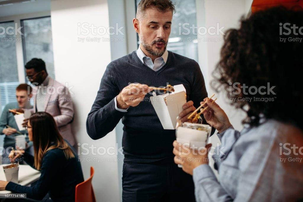 Business people having lunch break.
