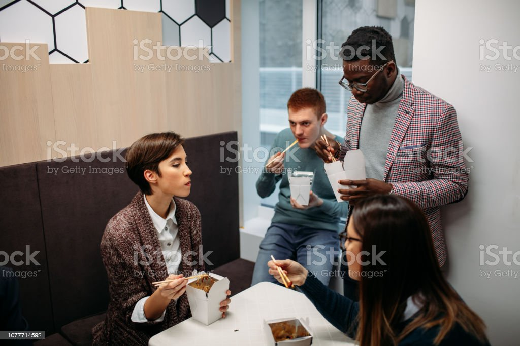 Young business people having lunch break.