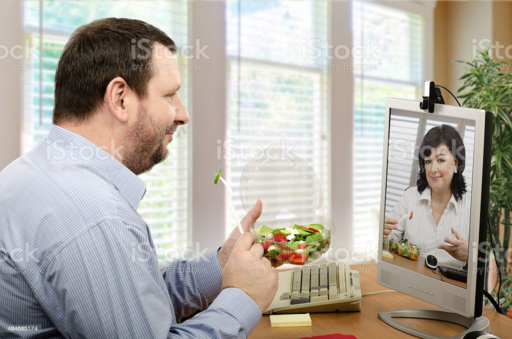 Two managerial accountants have ordered takeaway vegetable salad....