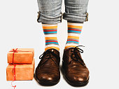 istock Office Manager in stylish shoes and bright socks 1130342019