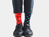 istock Office Manager in stylish shoes and bright socks 1131453104