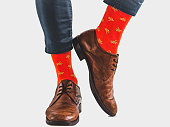 istock Office Manager in stylish shoes and bright socks 1131453118