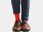 istock Office Manager in stylish shoes and bright socks 1131453158