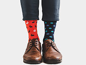 istock Office Manager in stylish shoes and bright socks 1131453207