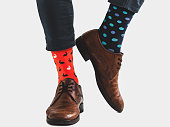 istock Office Manager in stylish shoes and bright socks 1131453241