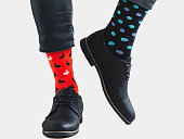 istock Office Manager in stylish shoes and bright socks 1131453364