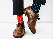 istock Office Manager in stylish shoes and bright socks 1154121019