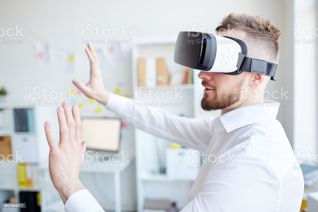 Office manager in VR goggles stock photo