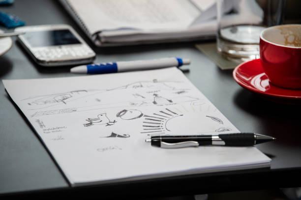 office meeting doodles on desk - scarabocchio disegno foto e immagini stock