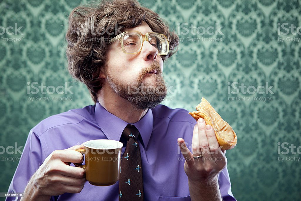 Office Nerd Eating Donut with Coffee royalty-free stock photo