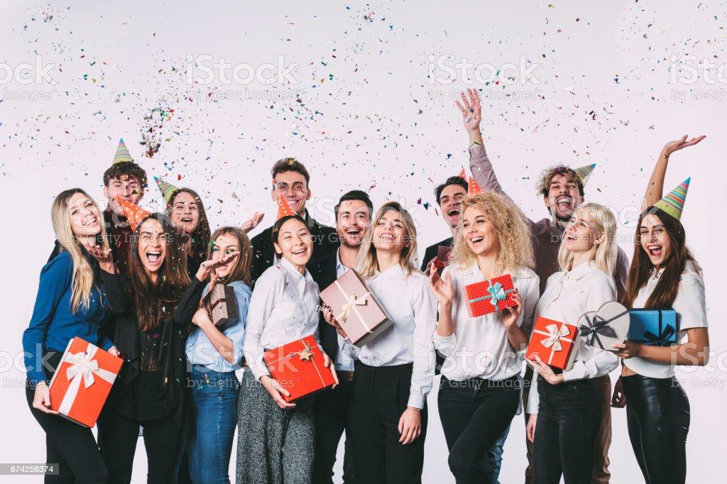 事務所の新年会。若い人たちは、楽しい時を過します。 ストックフォト