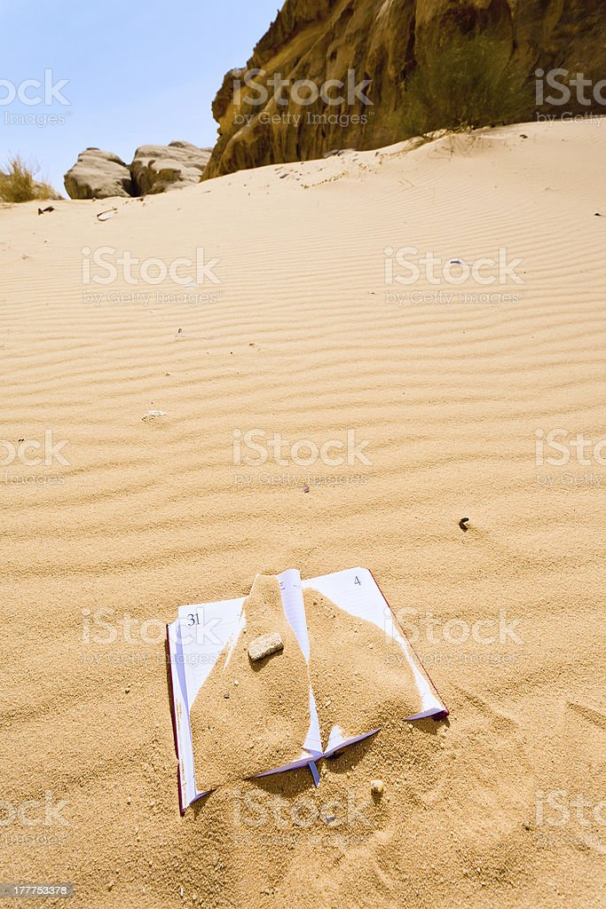 office note book in red sand of dessert royalty-free stock photo