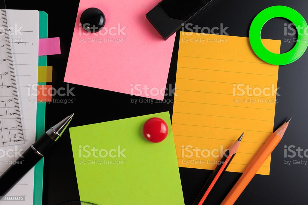 Office objects over blackboard background. stock photo