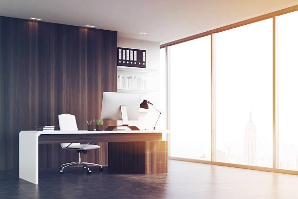 office of company head with dark wood walls, toned - amministratore delegato foto e immagini stock