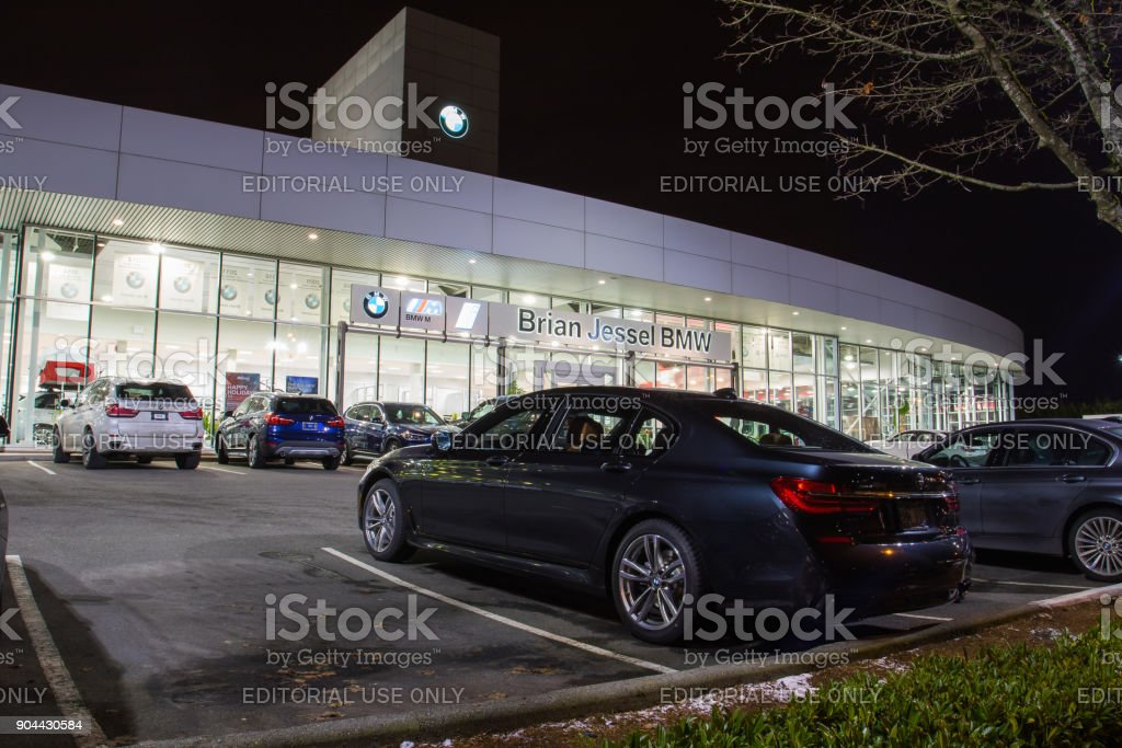 Vancouver BC, Canada - January 9, 2018: Office of official dealer BMW. BMW is a German automobile manufacturer specializing in high-performance and luxury cars. Night shot all is illuminated. stock photo