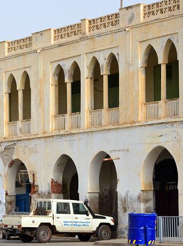 Office of Refugee Affairs vehicle and Casa Bahandum, 1910s colonial architecture, Massawa, Eritrea