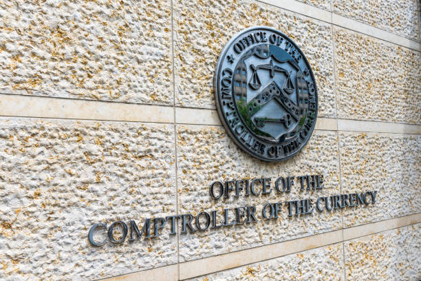 Office of the Comptroller of Currency sign and logo in downtown stock photo