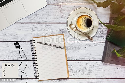 istock Office or freelancer workspace with to do list and laptop 831676330