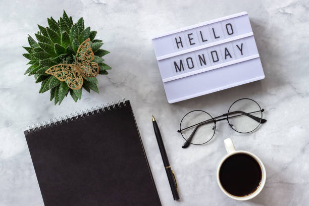 office or home table desk. lightbox text hello monday black notepad, cup of coffee, succulent, glasses on marble background concept stylish workplace flat lay top view - monday motivation stock photos and pictures